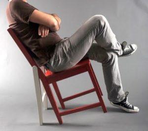 Неправильное положение на стуле